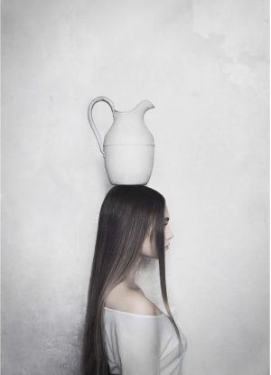 Balance poster with a woman balancing a jug on her head.