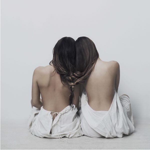 Two women with hair and shoulder together making a soul bound poster
