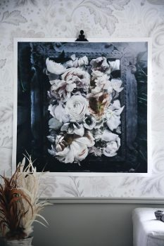 A print with pink flower in frame