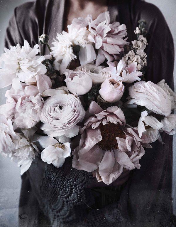 Woman having his or hers armful of flowers print