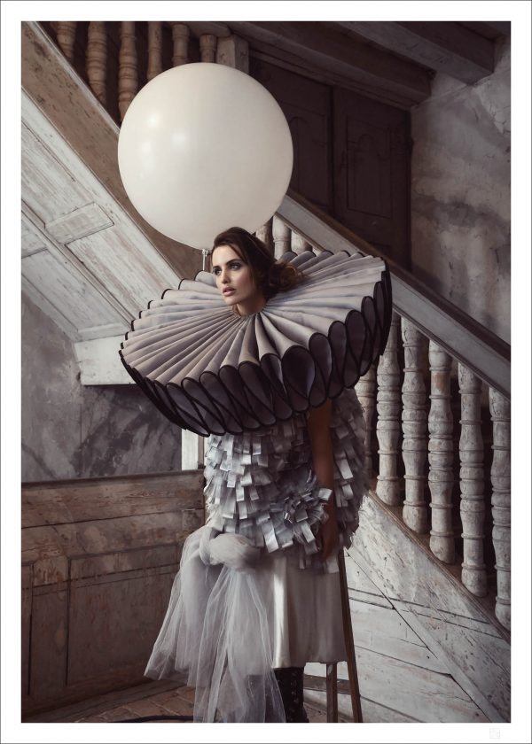 Woman with ballon on ladder poster