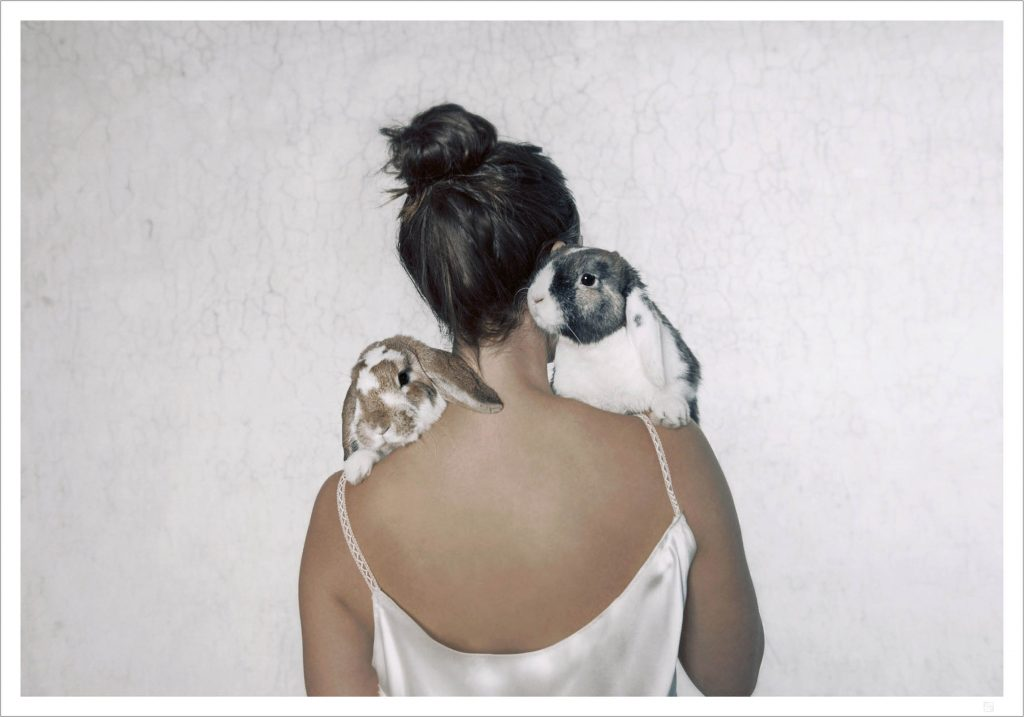 A woman with two cute bunnies on her shoulders. that is our Girl and bunny poster