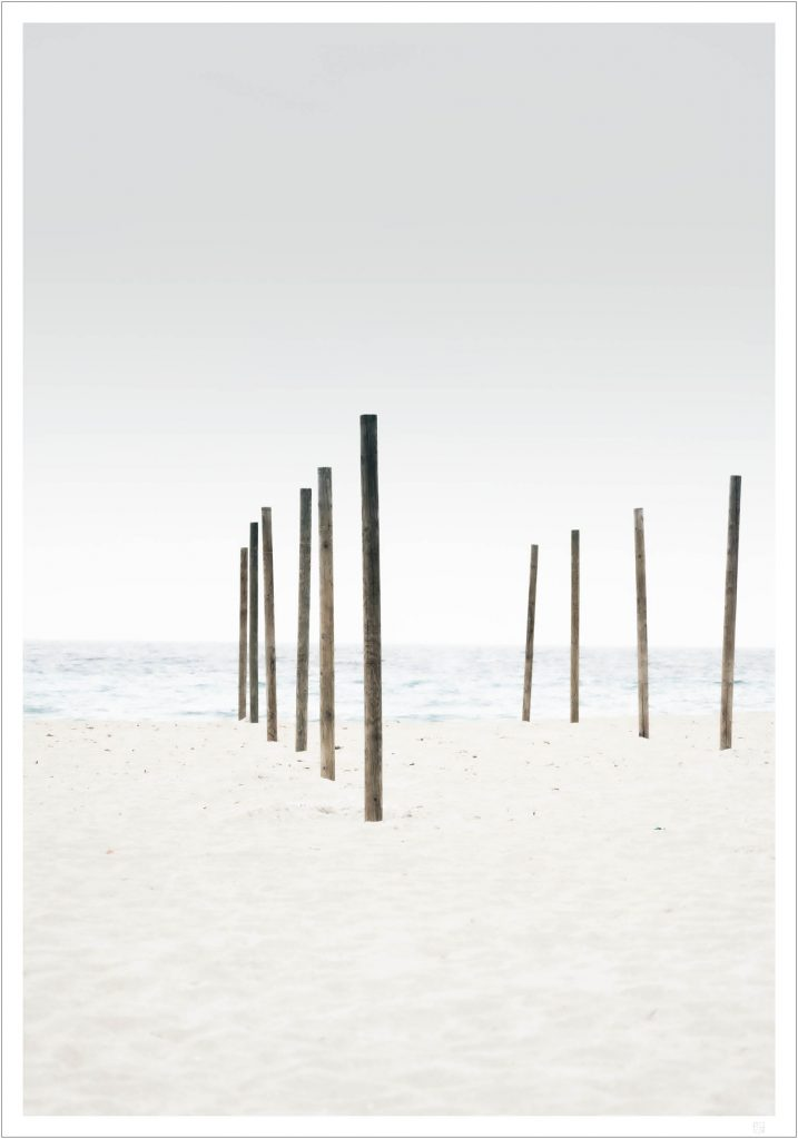 parasol pillars on the beach poster