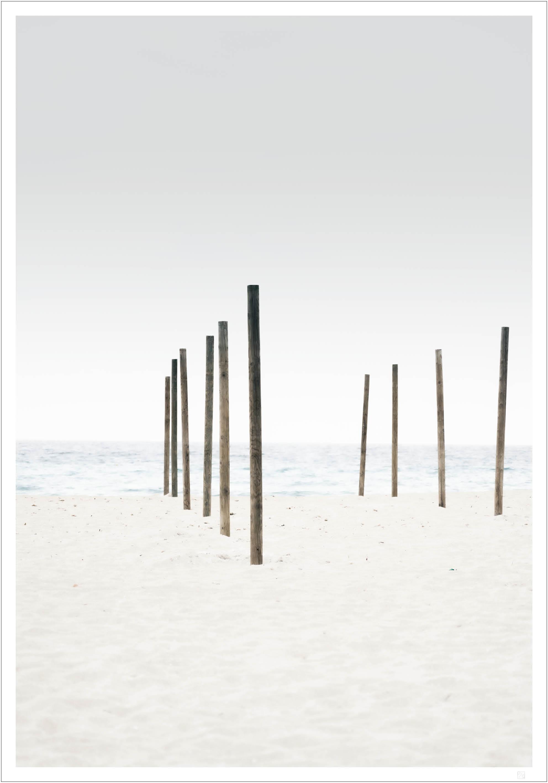 parasol pillars on the beach poster