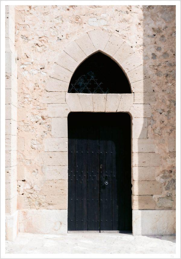 A black door on a very old building Here we have black door poster