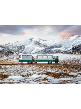 Green bus in the alps at its last stop